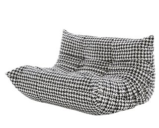To celebrate 40 years of Michel Ducharoy's iconic Togo sofa, Ligne Roset is releasing the collection in two new upholstery patterns, including the black and white houndstooth seen here.