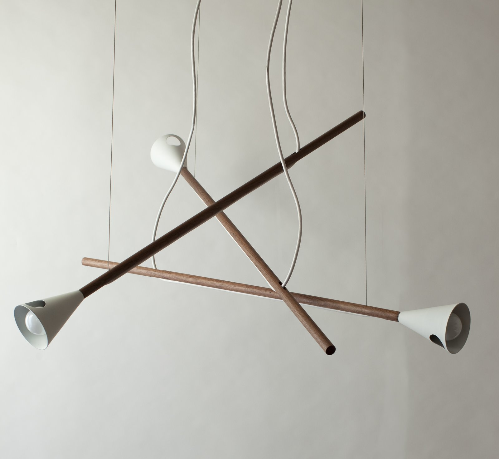 The Stokk chandelier by Urbancase from Standard Socket's first collection consists of one to five walnut arms, all adjustable by the user.  Checking In On WantedDesign 2013 by Sara Carpenter