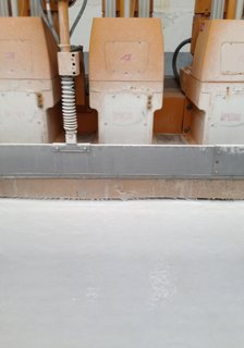 The cut slabs are buffed and polished. See a Vine video clip of the machine in action here.