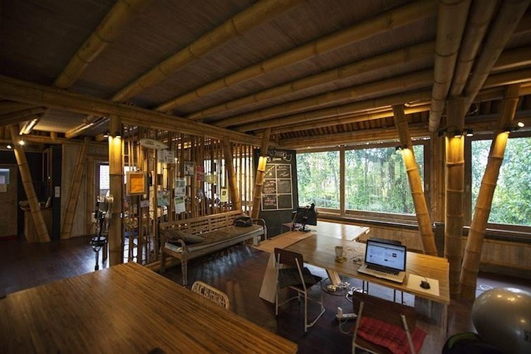 Hubud (Bali, Indonesia)   Some might say they're ruining paradise by installing high-speed internet. But if you can manage work-life balance, the all-bamboo interior of Hubud in Bali might be the perfect place for a work vacation or extended sabbatical. Built with sustainable materials, such as ironwood, the office boasts an airy environment with views of a rice field and volcano that most start-ups can't beat.  Photo 5 of 13 in 13 Inspiring Coworking Spaces