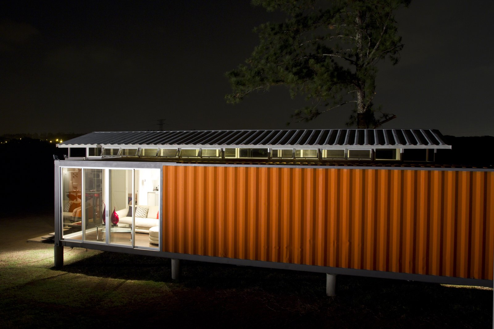 """Exterior, House Building Type, and Shipping Container Building Type The home was built by two construction workers and the couple themselves, who were familiarized with the construction process and had backgrounds in industrial engineering. """"We did not have blueprints for this design, and created only a 3-D model to guile them along the way,"""" Saxe says.  A Budget-Friendly Shipping Container Home in Costa Rica  by Tiffany Jow from House of the Week: Comfortable Home Made of Two Shipping Containers"""