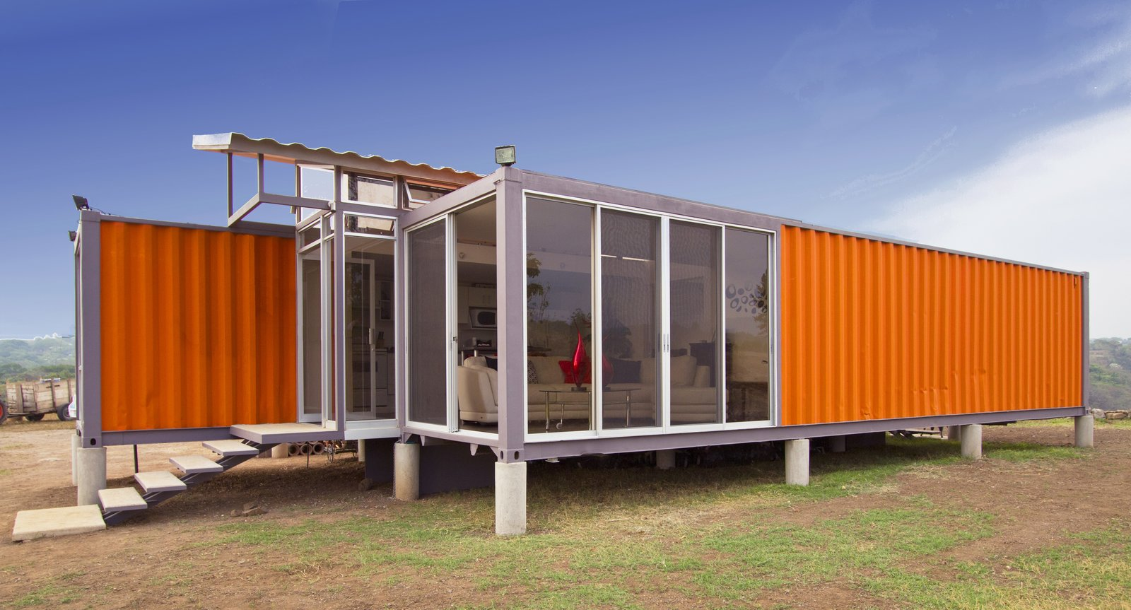 Set slightly apart, each container is installed on pier foundations.  A Budget-Friendly Shipping Container Home in Costa Rica  by Tiffany Jow from House of the Week: Comfortable Home Made of Two Shipping Containers