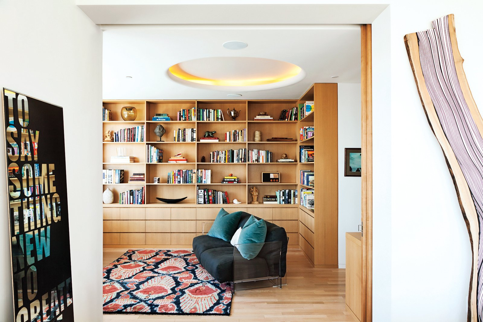 Living Room, Sofa, Rug Floor, Light Hardwood Floor, and Ceiling Lighting Located in West Village, designer Suchi Reddy constructs a modern family-friendly apartment.  Lovely NYC Abodes That Will Give You Apartment Envy by Allie Weiss from A Look Into 5 New York Apartments