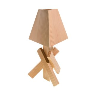 """The brainchild of Cincinnati-born and Brooklyn-based designer Paul Loebach, Areaware's Shanty Lamp ($75) is crafted from pine and references """"Shinto temples and humble wooden cabins."""" We think it's more the latter than the former, and love that it has a scrappy sensibility and affordable price tag. More a showpiece than a streaming light source, the table lamp illuminates with a five-watt bulb."""
