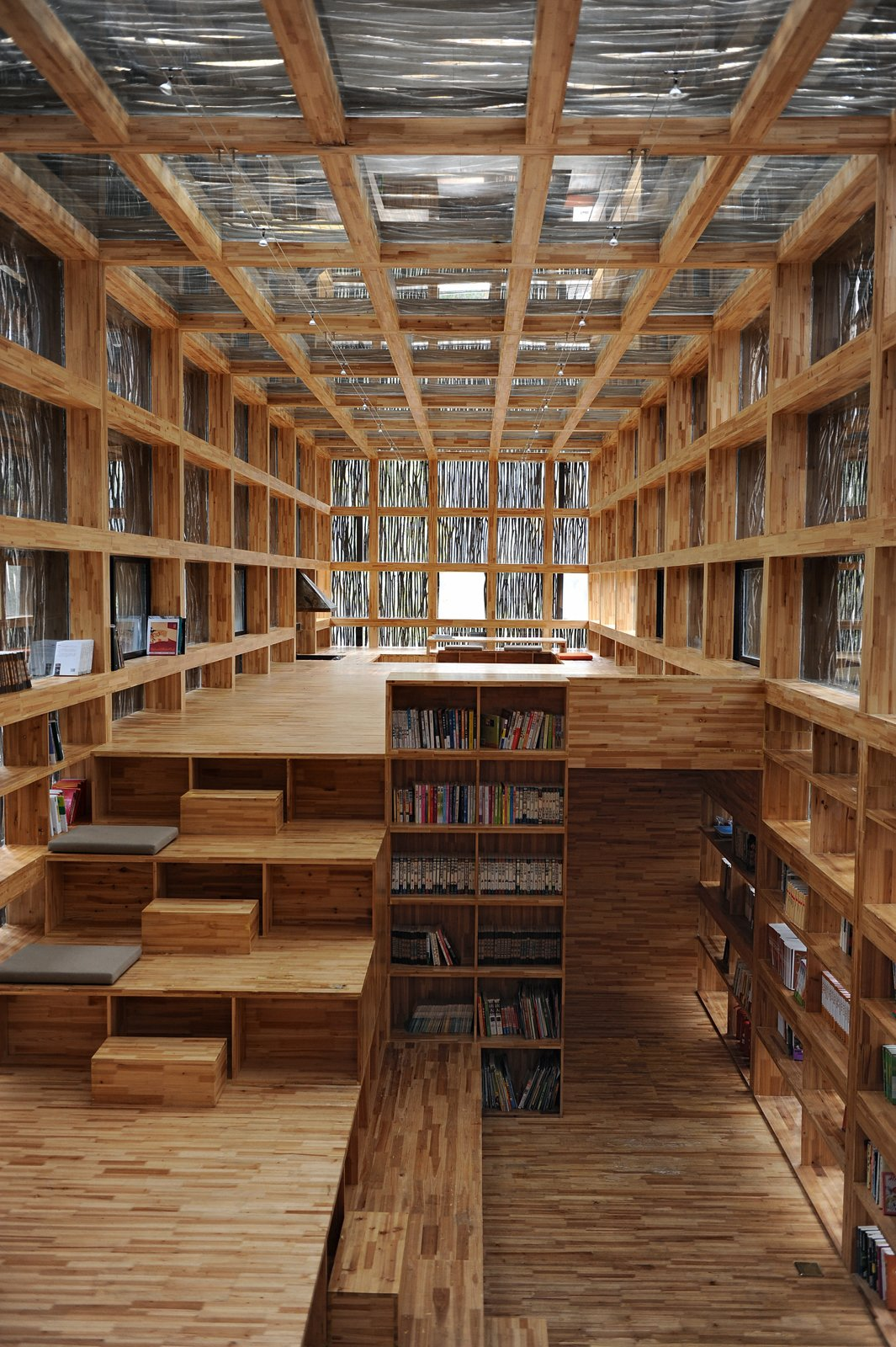 The Li Yuan Library's coffered walls provide a built-in storage solutions for all those books. Li Xiaodong, Li Yuan Library, Jiaojiehe Village, Huirou, Beijing, China. Photo by Li Xiaodong Atelier.  Read from Wood Architecture Now! Volume 2 by Philip Jodidio
