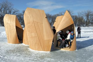 Skaters seeking refuge from strong winds and temperatures feeling as low as minus fifty degrees Celsius can thank Patkau Architects for the Winnipeg Skating Shelters. The structures are formed from two layers of plywood and a timber frame. Winnipeg, Manitoba, Candada. Photo by James Dow.
