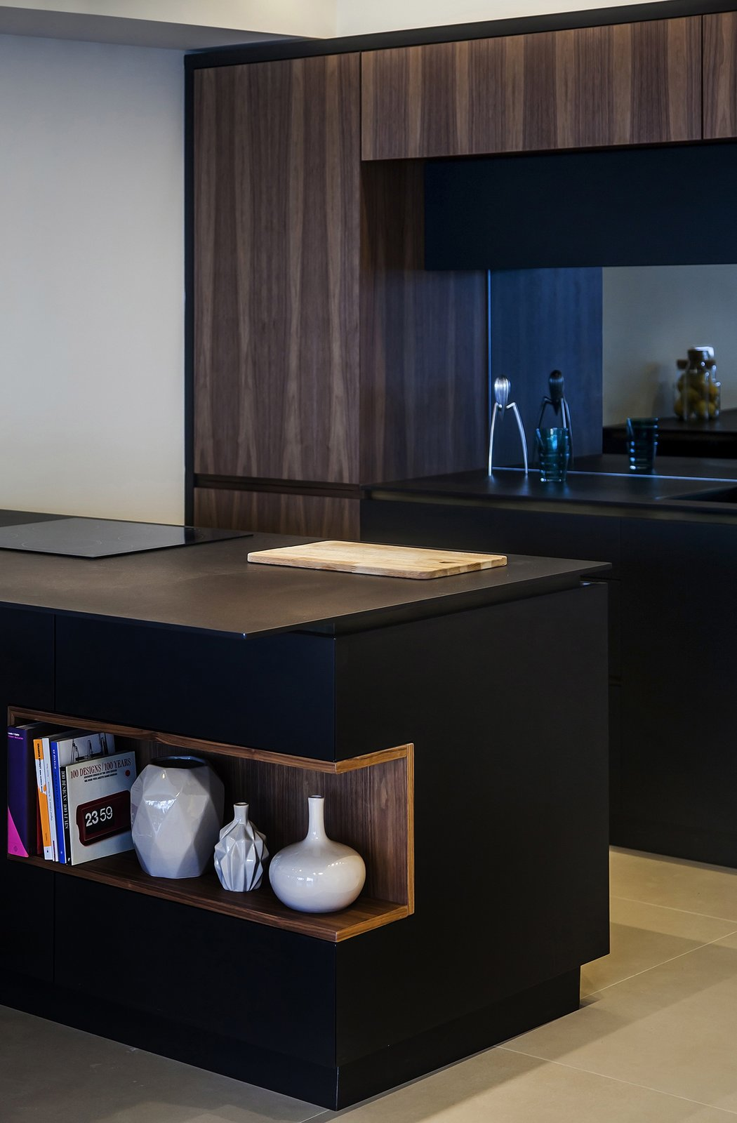 Kitchen, Wood Cabinet, and Wood Counter The custom island also features a cut-out shelf.  A Compact, Renovated Apartment in a Tel Aviv Tower by Allie Weiss