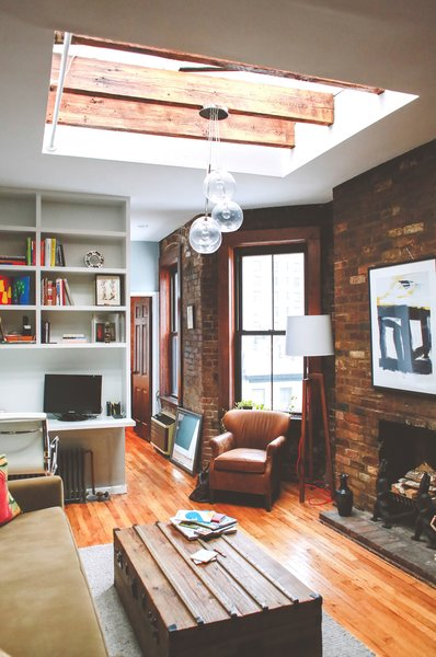 The best way to make a small space work is to find the hidden gems. The high ceilings, exposed brick and ridiculous skylight in this Chelsea one-bedroom gave us a pretty good foundation to go mountain-man modern. Photo by Chellise Michael Photography.