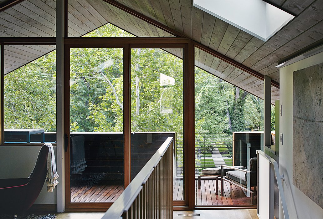 Living Room and Chair A third-floor office, furnished with a Metropolitan chair by Jeffrey Bennett for B&B Italia, opens onto a deck that overlooks the backyard.  Photo 7 of 10 in This Kansas City Home Looks Like Its Neighbors, But Reveals a Truly Modern Sensibility