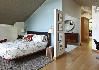 In the master bedroom, a pair of Artemide Tolomeo sconces bookend a Matchbox bed by Edwin Blue.