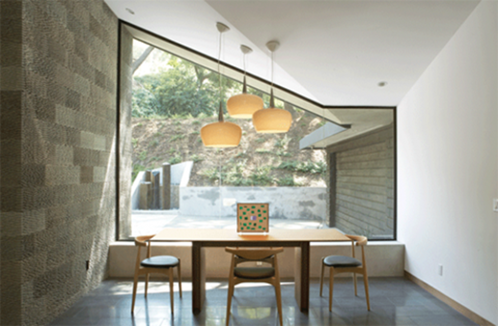 The dining area of the Kim Residence is encased in glass walls and doors, lending a sense of dining al fresco.  Photo 2 of 10 in Dwell Los Angeles Home Tours Day #2 Preview: East Side and Downtown