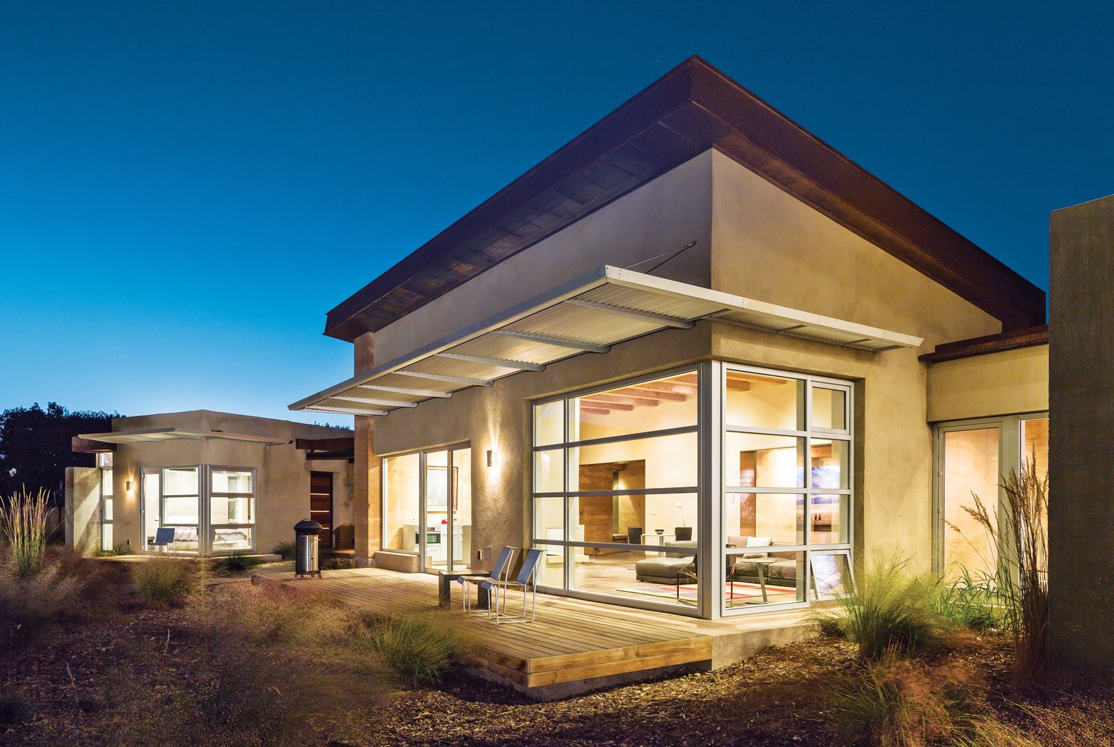 Exterior, House Building Type, and Stucco Siding Material Because the night air cools the walls in summer, the home has no air-conditioning—though daily highs often rise into the mid-90s and above. Photo by: Kirk Gittings  Photo 4 of 5 in A Sustainable Rammed Earth Home in New Mexico