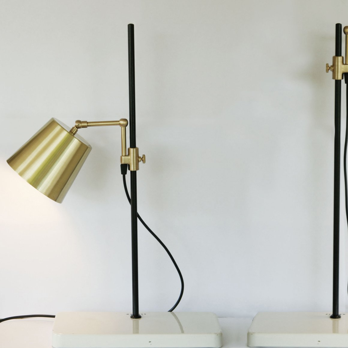 This striking brass desk light from South Africa-based Anatomy Design can raise, lower, and swivel on its metal rod, to provide just the right amount of light in just the right place.  Modern Task Lights by Jaime Gillin