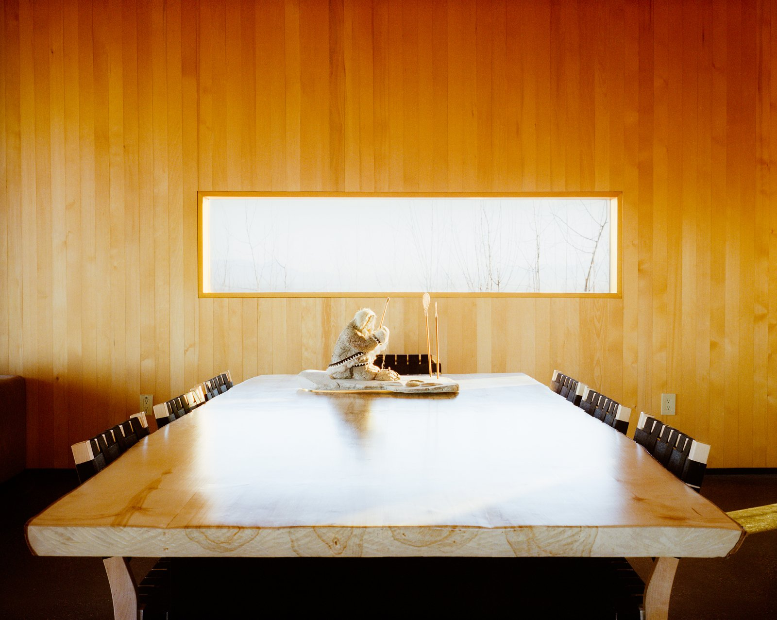 Dining Room and Chair Buser made the dining table which is surrounded by Chair 611s by Alvar Aalto for Artek.  Photo 3 of 20 in This Modern Cabin Is the Ideal HQ For a Family in Alaska