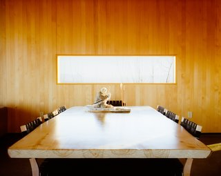 Buser made the dining table which is surrounded by Chair 611s by Alvar Aalto for Artek.
