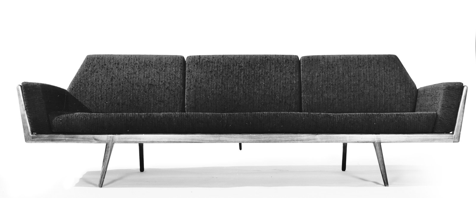 A handsome sofa from the Smilow-Thielle Rail Back Collection is distinguished by walnut dowels surrounding the piece's sides and back. Photo courtesy of the Smilow Family.  Photo 2 of 7 in Mid-Century Designer Focus: Mel Smilow