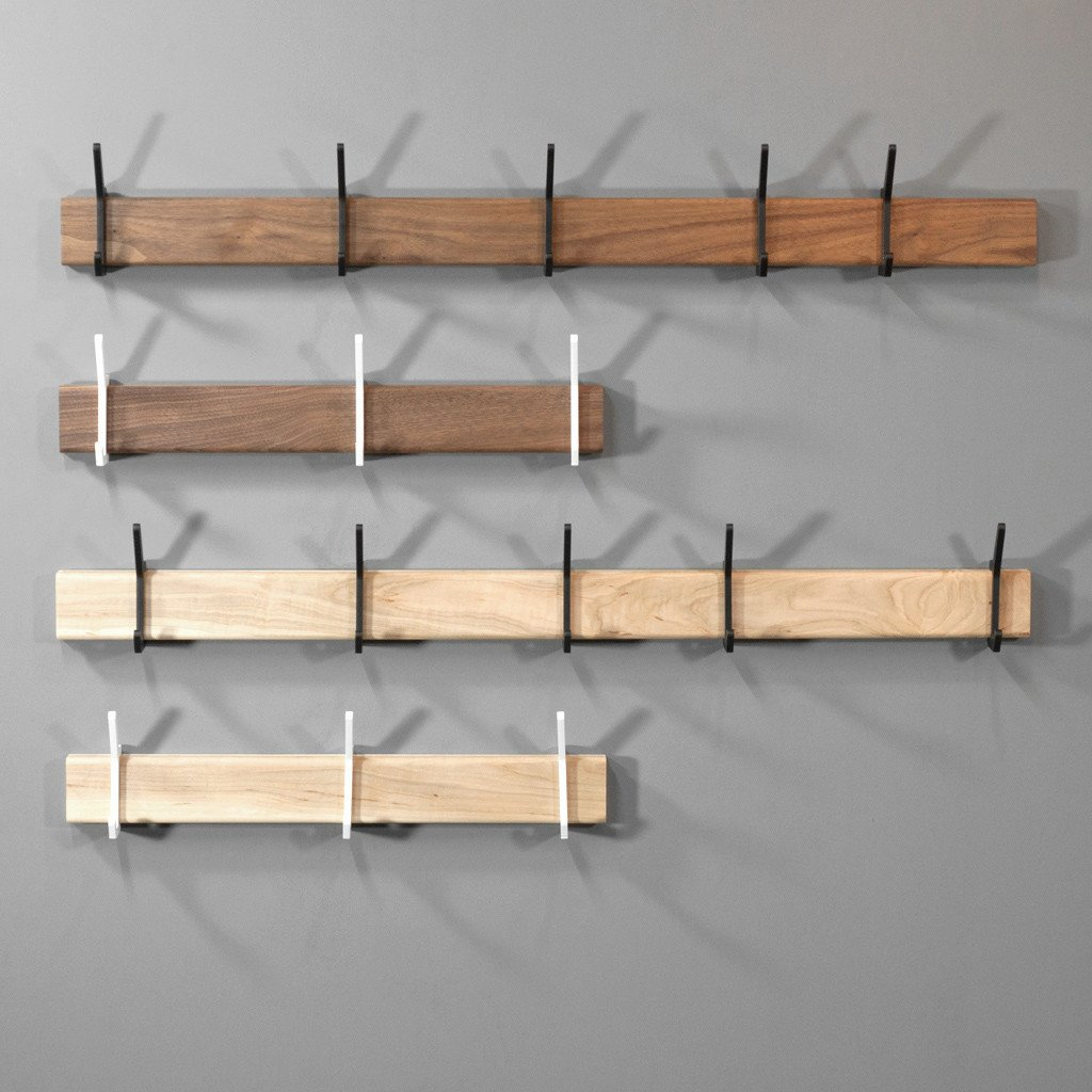 Isabella Furniture's Federal hook system, which Dwell featured in our July/August issue, features laser cut steel hooks that slide along a grooved wooden form. Available in black walnut or maple with black or white hooks; $195.  Photo 3 of 6 in 6 Quick Fixes to Eke Out More Closet Space from More Pieces from American Designer Paul Isabella