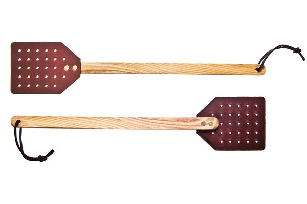 Leather fly swatter by Dennis Knight for Kaufmann Mercantile  $14 Handmade from leather and ash wood by an Ohio-based Amish craftsman who learned his craft in a colonial Williamsburg saddle shop.