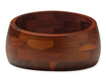 This Salad Bowl is made from acacia wood. The Graves office wanted to up the level of materials used in this collection, but found that instead of getting jcpenney's Chinese manufacturers to work with American woods, it was far better to design them in woods native to China.  Photo 4 of 5 in Donald Strum: Behind Great Product Design