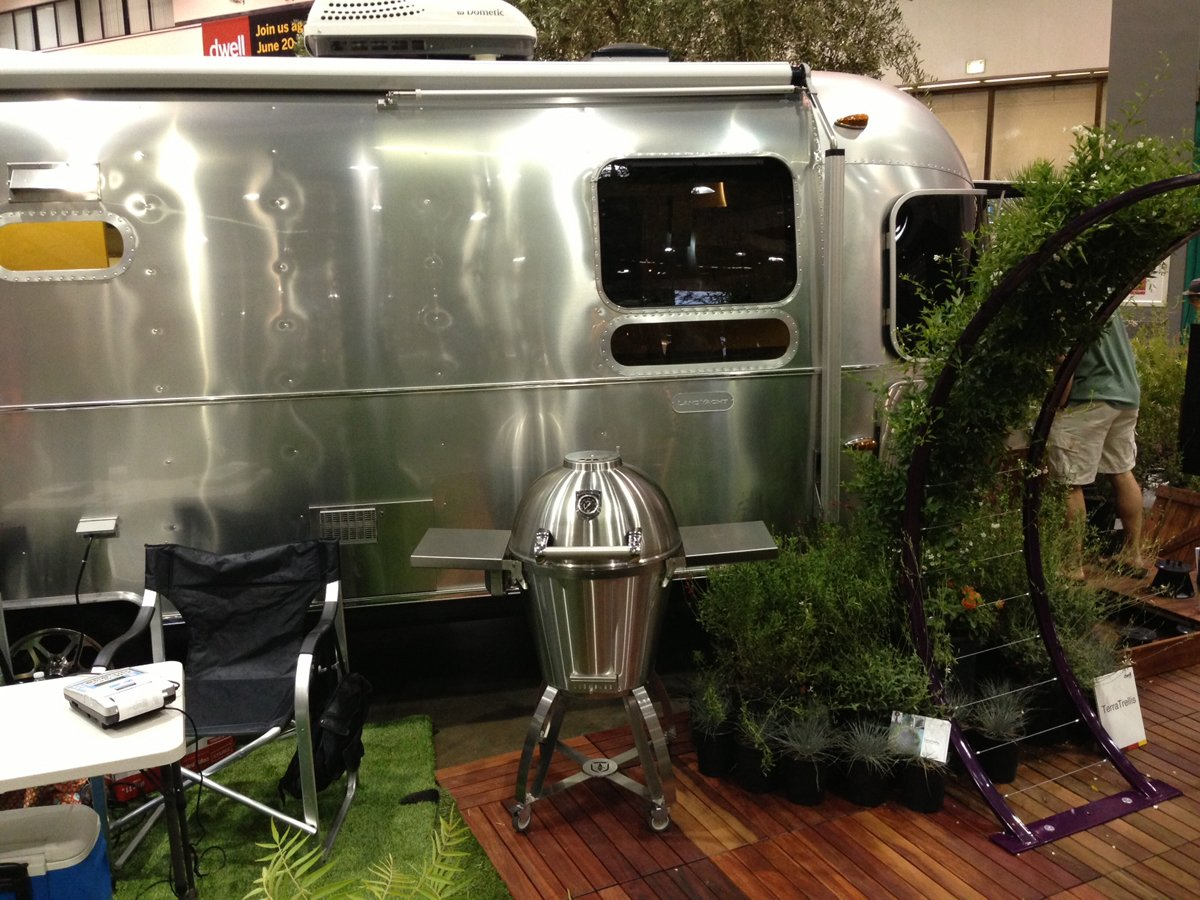 Best grilling environment: Caliber ThermaShell Pro Stainless Steel charcoal grill in front of Airstream's new LandYacht.  Photo 11 of 17 in Dwell on Design Editors' Picks