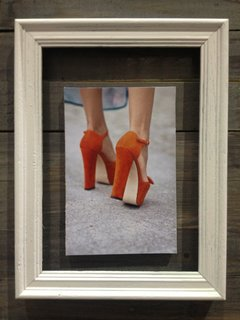 Among Peterson's inspirations was sky-high orange suede heels.