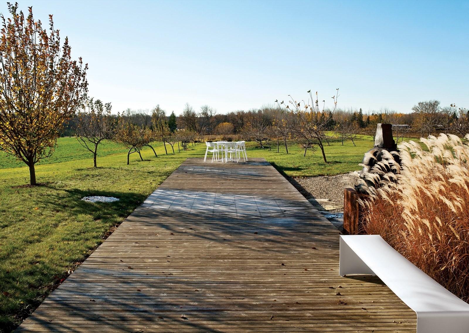 """Outdoor, Large Patio, Porch, Deck, and Wood Patio, Porch, Deck The deck in the """"memory orchard"""" of the Field House.  Unique Modern Decks We Love by Zachary Edelson from An Architect References Local Architecture to Build a Modern Home"""