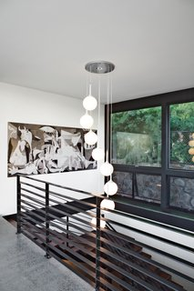 Pink & Brown's Corkscrew Pendant Lamp lights the stair leading to the  family room