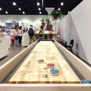 Fancy a game of shuffleboard? Head over to the @dwell_store's booth at #Dwellondesign and try your hand.