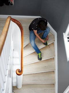 Charrier's son, Fabian Fonnesbæk Charrier, 14, pauses on a staircase of white oil-finished pine floorboards.