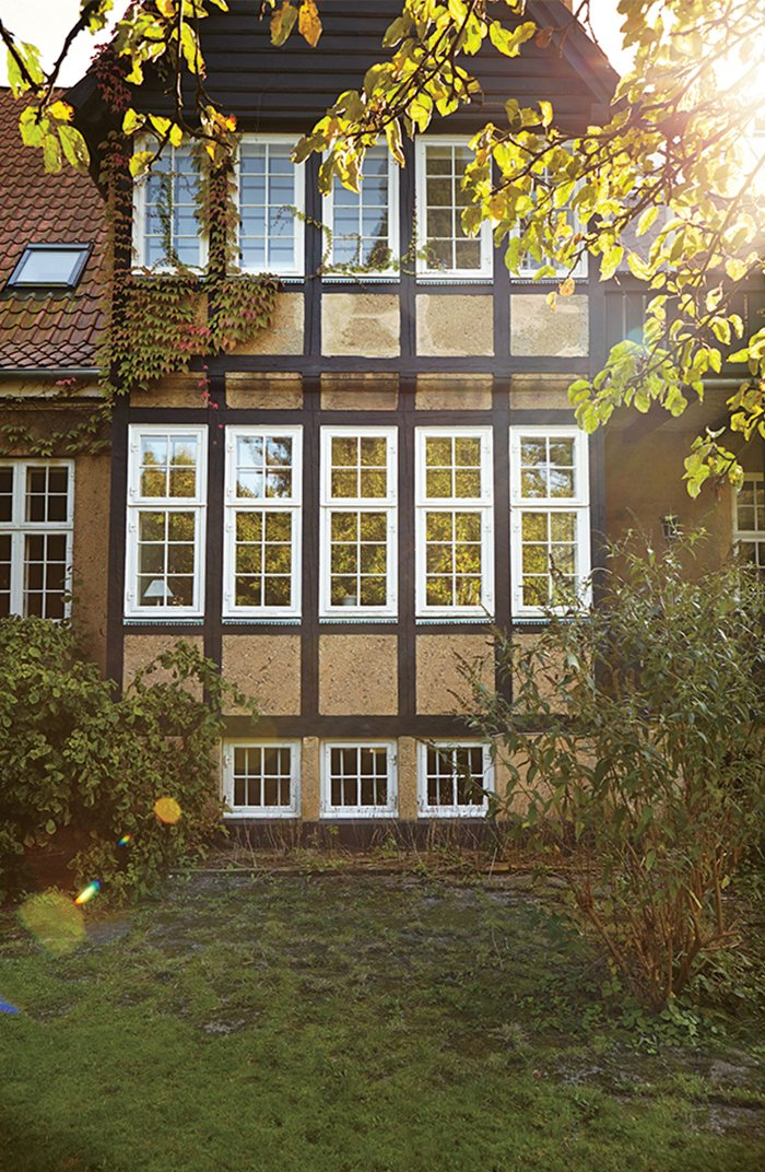 Exterior, House Building Type, and Gable RoofLine The family, who reside on the top two floors of this two-family Tudor-style house, kept many of the building's original windows.  Modern Danish Homes We Love from A Cramped Attic Became a Sunny Dining Room in this Renovation of a Copenhagen Tudor