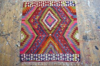 Roughly four-foot-square vintage flatweave rug from Turkey with a geometric pattern, sold by Aelfie. ($410)