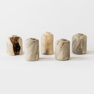 Bay Area designer Melanie Abrantes's wood bud vases are one-of-a-kind and handmade from walnut, cherry, and buckeye burl wood. Each bud vase is made through the technique of lathing in Abrantes's Oakland studio. The vases can hold a single flower or two, and include a glass vial to hold the water and fresh flowers.