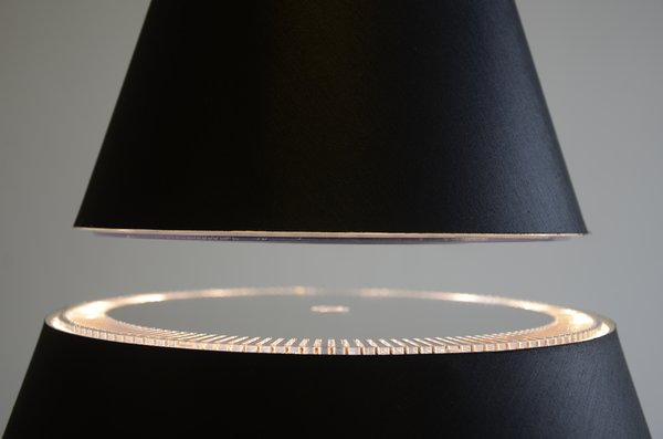 Both the Eclipse and Silhouette lamp models produce light with low-energy LED bulbs embedded in the lower half of the lampshade.