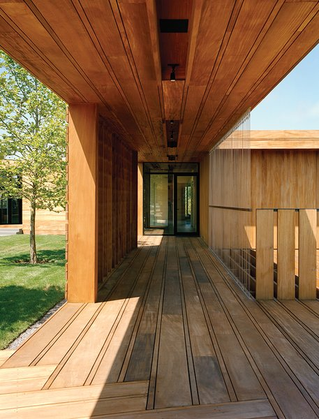 Contractor Keith Romeo worked with Bates Masi on the varied mahogany planks used for the exterior decking, which are finished simply with wood toner by Cabot.  Homes with Wings by Allie Weiss from Modern Wood-Lined Family Home in the Hamptons