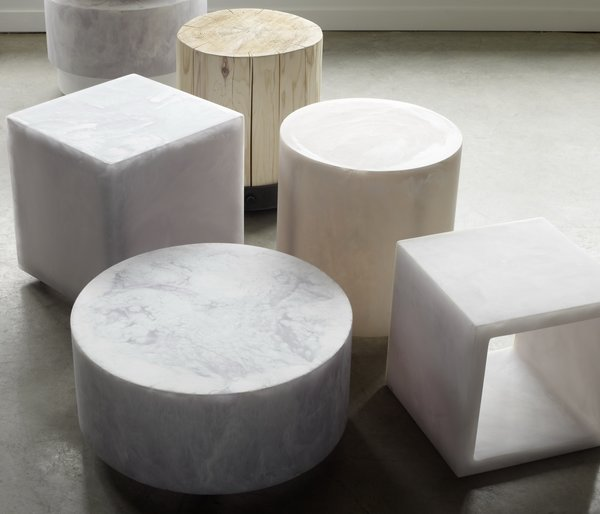 Various marble (and one wooden!) round and cube stools elegantly occupy the floor. Use it add a sculptural piece or as small tables.