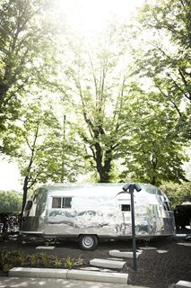 """The Trailer"" is a 1952 22-foot Silver Creek Clipper completely converted into a 112 euro-per-night room. The trailer redesign was overseen by Hansjorg Kofler and is referred to as ""the island"" of the hotel. The Airstream was completely stripped and refitted with thermal insulation, soundproofing, A/C, wifi, and hot water."