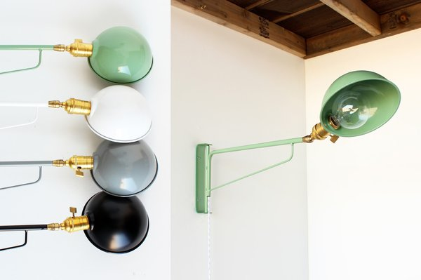 Coming soon is a powder-coated industrial wall lamp with a rounded shade, available in four shades ranging from classic black to a retro green. ($225)