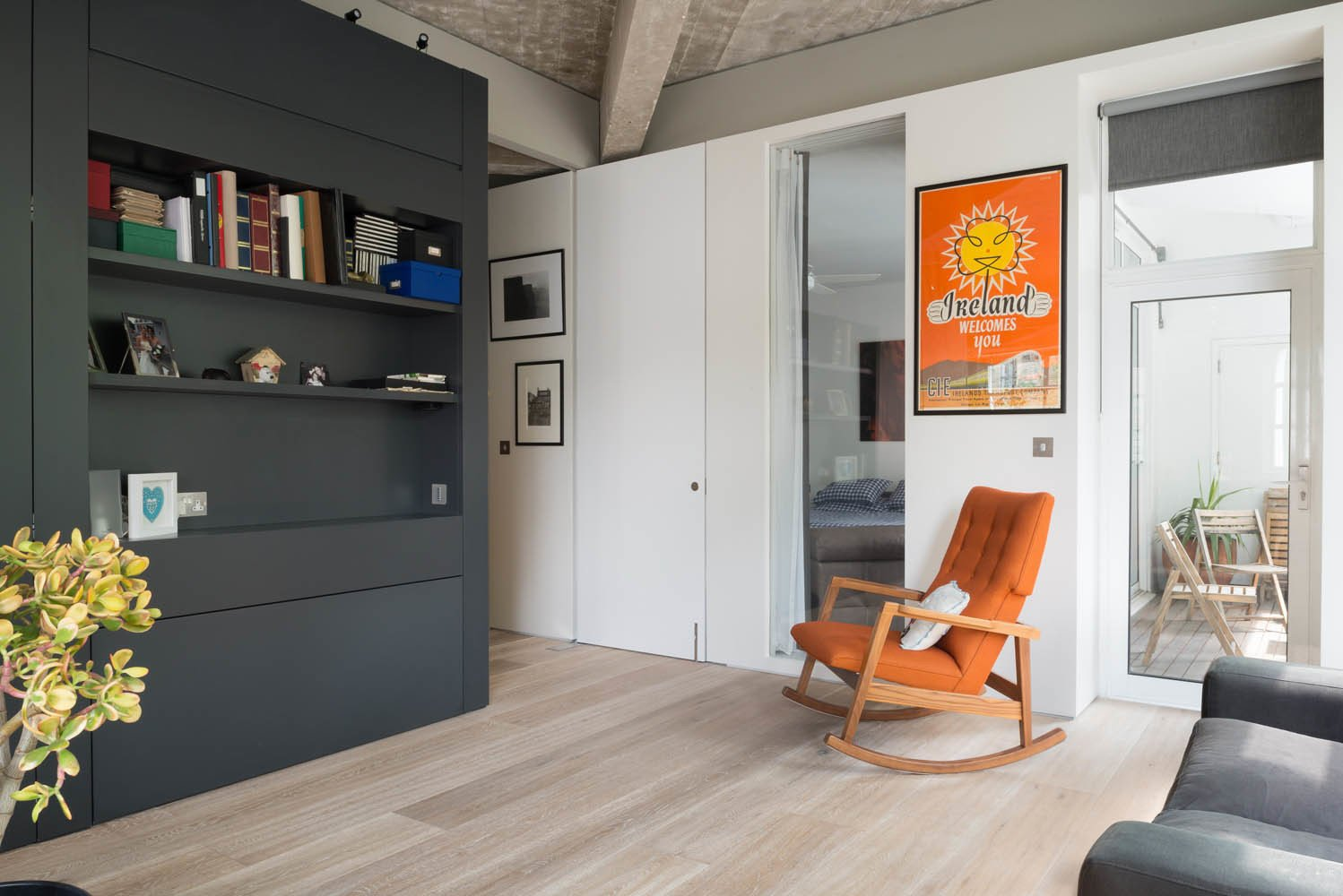 The architects carved out a small sitting area outside a bedroom. The partitions are either painted plasterboard, lacquered medium-density fiberboard (MDF), or veneered MDF. Photo by Jim Stephenson.  Photo 6 of 8 in Renovation Opens Up a London Apartment