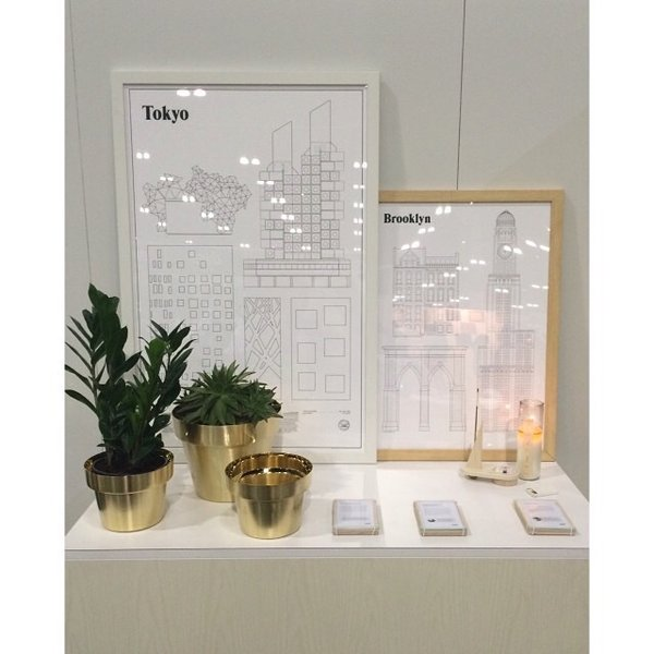 Designed by Monica Förster, the Brushed Brass Flower Pots celebrate the shape of traditional terracotta pots and elevates the look with a luxurious material selection. Maintaining the historical production methods of the Skultuna factory, these flower pots are made through the traditional practice of metal spinning.  Photo: Dwell on Design 2015, shown with Tokyo Elevations Print and Brooklyn Landmarks Print from studio esinam and Forma Sculptural Candle Set from Bower.