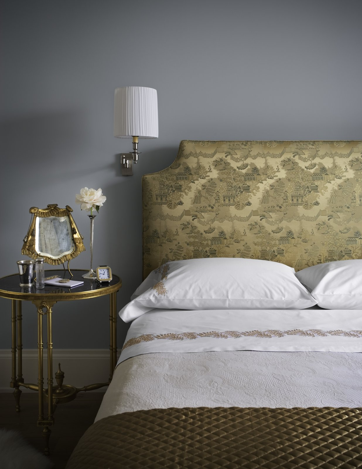 In her book, Interiors, the designer describes how a trip to Tibet delivered a vision of the serenity she wanted to recreate in her own living space. Part of this involved relocating her bedroom to the rear of the building. The Scalamandré fabric used on the headboard and bed skirt fabric was chosen because the colors and patterns recall sepia-toned prints of the ancient city of Machu Picchu.  Bedrooms by Dwell from An Interior Designer's Artful and Art-Filled NYC Town House