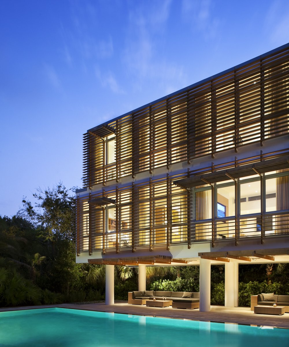 Outdoor, Back Yard, Trees, Shrubs, Walkways, Large Patio, Porch, Deck, and Large Pools, Tubs, Shower Stephen Yablon Architect added on a striking modern pavilion to a traditional beach house in Sullivan's Island, South Carolina. The ipe-wood louvered addition is only 15 and a half feet wide. Photo: Michael Moran.  Photo 2 of 16 in 5 Energy-Efficient and Stylish Ways to Shade Your Windows from Modern Sun Screens
