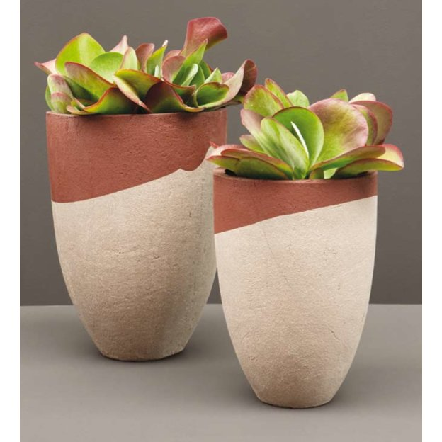 "Berlin-based Atelier Hors-Serie's AT collection comes in natural or contrasting engobe finishes, which give the planters unique color combinations. From $63  Search ""faceted planter"" from Perfect Planters for Your Garden"