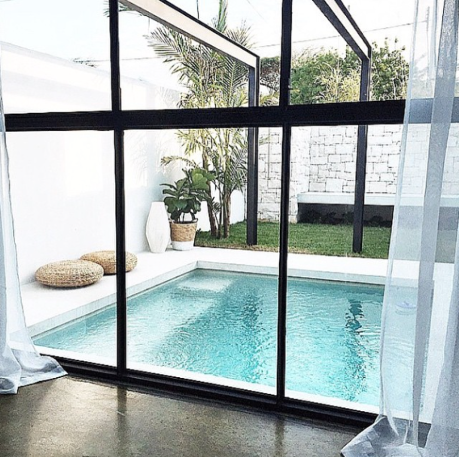 @mon_palmer: A decision to change our sliding door to steel bifold windows opened up a completely new option as to how we could design our garden. The before and afters are dramatically different.  Modern Pool Design by Dwell from Photos of the Week: 7 Inspiring Outdoor Spaces from Our Readers