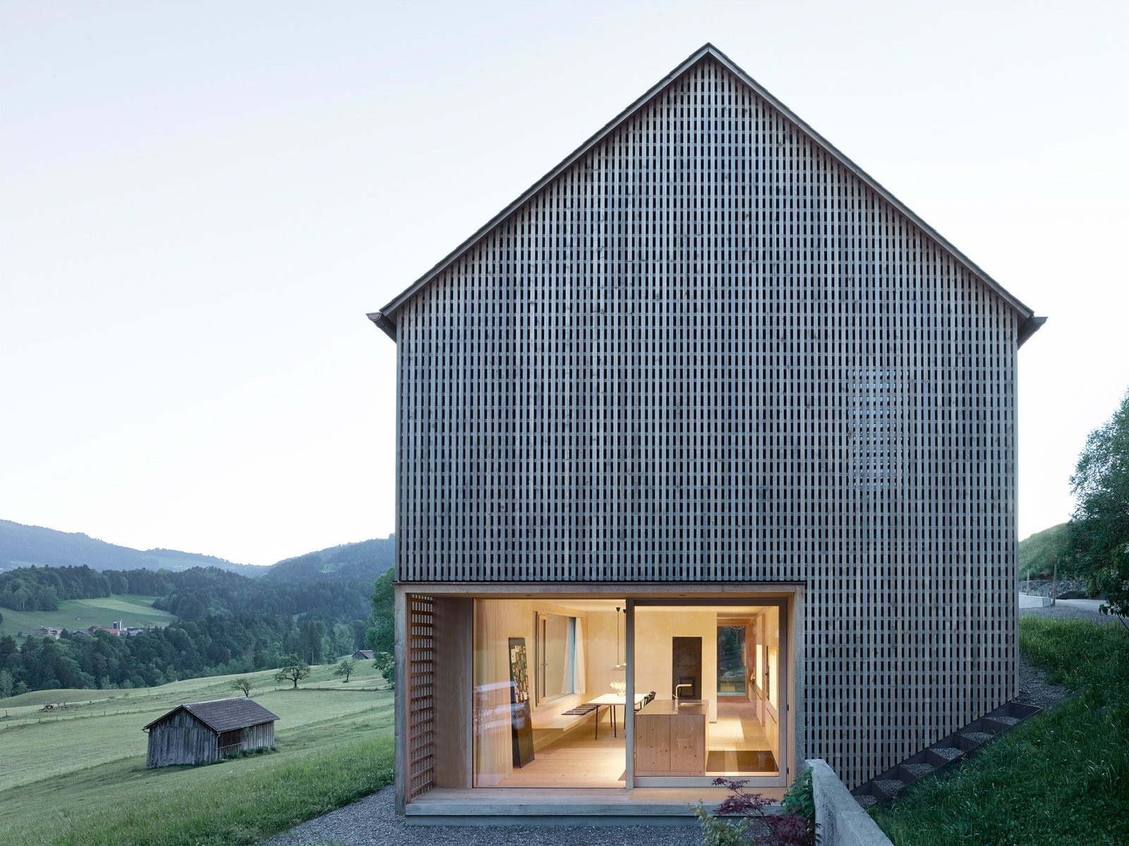 Articles about simple gabled house features intricate latticework shell on Dwell.com