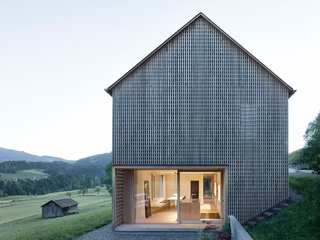 A Simple Gabled House Features an Intricate Latticework Shell