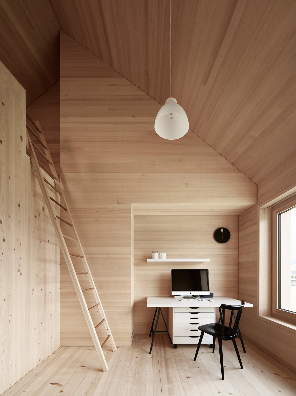 Spruce wood also lines the floor, walls, and ceiling in the bedrooms. The residents must climb a ladder to access the loft above.  Clever Loft Spaces for Small Places by Diana Budds from House For Julia Björn