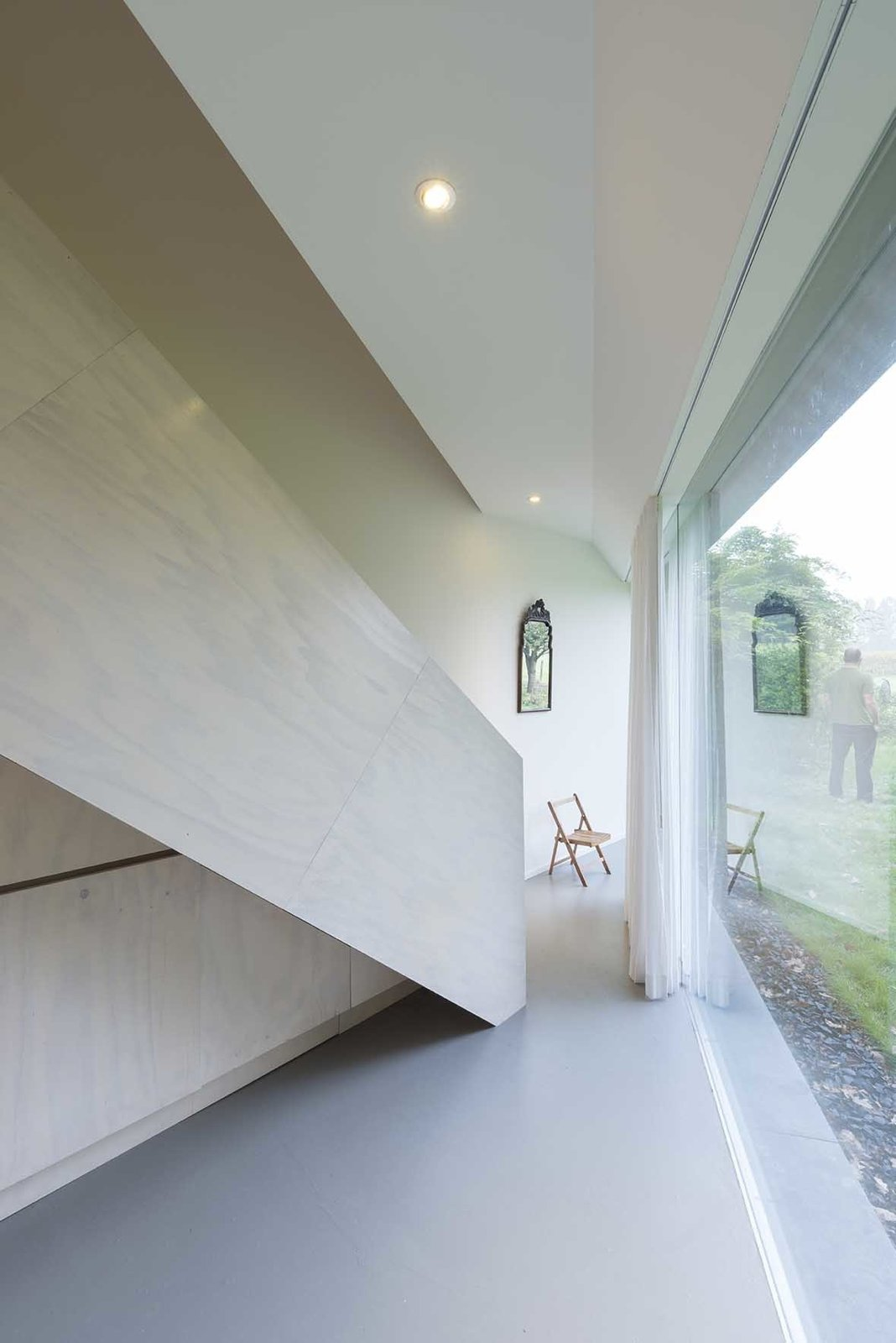 The architect minimized costs by keeping the detailing relatively simple. That naturally led to simple shapes and clean lines that enhance the home's minimalist feel.  190+ Best Modern Staircase Ideas from Triangular House