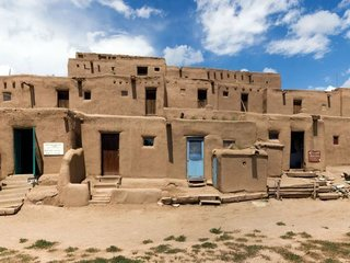 Taos Pueblo in Taos, New Mexico, has been the home of a Native American community for over 700 years. Built from adobe —a durable mixture of earth, water, and straw — the houses pictured here are still home to about 150 Pueblo Indians today. Photo via National Geographic