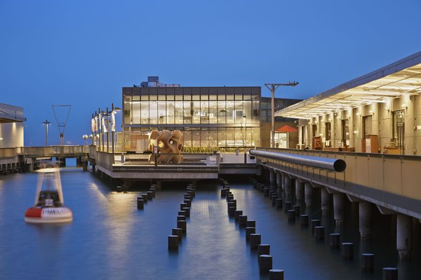 The Exploratorium museum, housed within the original bulkhead at Pier 15, accommodates four spacious galleries. The glass-and-steel Bay Observatory—the only new structure on the site—unites the Embarcadero with the bay. Photo by: Bruce Damonte.  Original architects: G.A. Wood, H.B. Fisher, A.W. Nordwell (1930s)  Contemporary architect: EHDD (2013)   Preservation architect: Page & Turnbull 2013