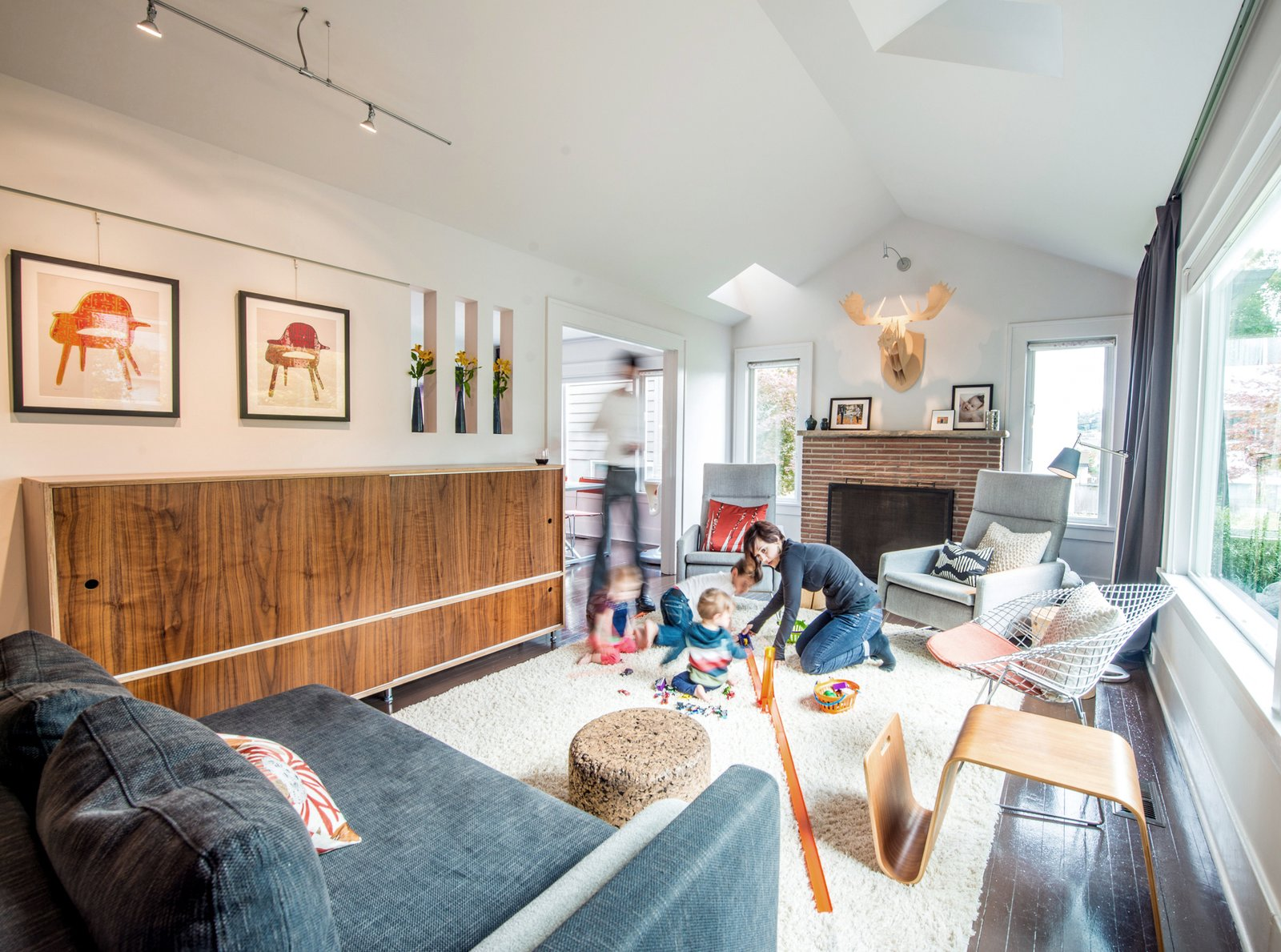 The Imhoffs vaulted the ceiling in their living room, dispensing with the old attic and carving out skylights to draw natural light into the space.  Photo 2 of 7 in Transformative House Renovation in Seattle